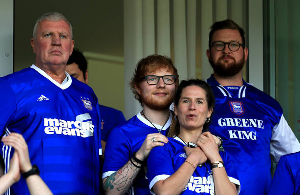 musician-ed-sheeran-and-fiance-cherry-seaborn-look-on-during-the-sky-bet-championship.jpg