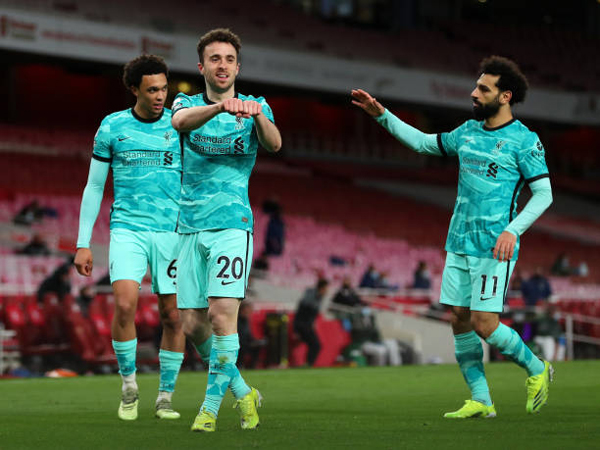 diogo-jota-of-liverpool-celebrates-with-teammates-trent-and-mohamed-salah.jpg